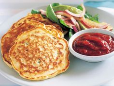 Corn fritters with rocket salad recipe - By Australian Women's Weekly, Add some sweet and spicy flavours to your favourite corn fritters with this tomato sweet chilli sauce and fresh rocket salad. Tomato Chilli Sauce, Sweet Chilli Sauce, Curry Recipes, Salad Recipes, Vegetarian Recipes, Damper Recipe, Pear Tarte Tatin, Potatoes Dauphinoise, Rocket Salad