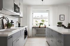 Grey kitchen, square subway tiles, kitchen island