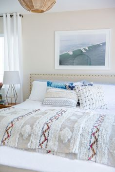 Layered textures in neutral cool bedroom