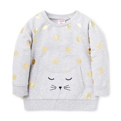100% Cotton. Long sleeve windcheater with snap buttons on weariers left shoulder for easy dressing. Features all-over gold foil spot yardage, raglan sleeves and front kitty face pocket. Regular fitting silhouette. Available in Cloud.