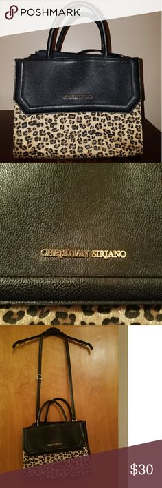 Christian Siriano Leopard Purse New, worn once(I have too many bags) and kept in great condition no wear/tear, no scuff marks. This bag has 5 compartments(in the front if you lift up the flap where the logo is, in the back, three in side)The leopard pattern on the front is litely fuzzy to the touch but no shedding or anything of that nature just an overall good item. Christian Siriano for Payless Christian Siriano Bags Satchels