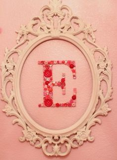 Buttons glued to a painted wooden letter...  simple, elegant, easy -- and gorgeous!!!