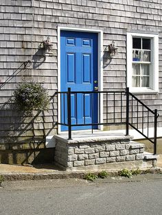gray house Blue Door