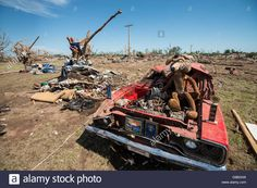 Moore, Oklahoma, USA. May 22nd 2013. Oklahoma tornado damage and cleanup efforts. A damaged Plymouth Roadrunner show car sits in front of a damaged home.  The car owner placed his trophies and plaques around the car. Credit: James Pratt / Alamy Live News Stock Photo