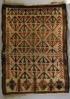Northeast Persia, late 19th century, (crease wear, end fraying), 3 ft. 10 in. x 2 ft. 9 in. Provenance: Estate of Grover Schiltz. $200-300 The absence of a condition statement does not imply that the lot is in perfect condition or completely free from wear and tear, imperfections or the effects of aging. Sold for: $861