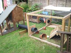 Bunnyopolis Mark 3 - the horseshoe run ends in two hutches (one 2 storey) with run in the middle.  Temp cover on base of one hutch to stop digging.  Additional run cover folded back.  Pipes from Connectives.  Run home-made.