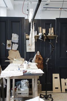 Nice mood and imagining the dark wall as division between kitchen and dining - just like the white against the dark navy blue. Not necessarily the panelling or all the other stuff. Although the doors - could be cool to look at different ideas for the snug cladding that are not as slick as new wood panels.