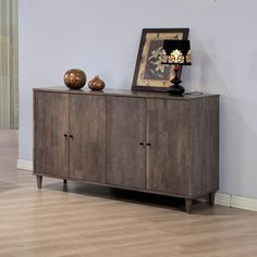Add a stylish look to any space with this light charcoal grey Vilas buffett. Adjustable shelving and a rubberwood construction finish this buffett.