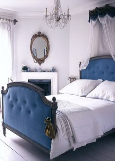 A blue velvet bed and white wood floors...divine.