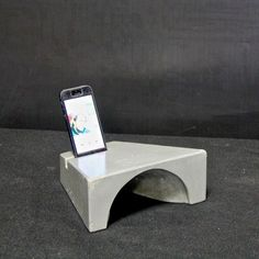 Iphone amplifier. Cast concrete acoustic speaker. Created by JONATHAN HAYWOOD EPIC ARTISAN CONCRETE
