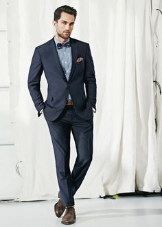Dark blue suit. Every men's must have item. #mens #style #suit http://www.moderngentlemanmagazine.com/how-to-build-essential-mens-wardrobe/