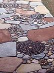 Welcome to Jeffrey Garden Design - This site has a lot of great Mosaic ideas for paths using different stones. Check it out!