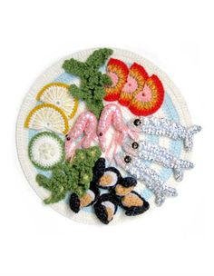 Many of Kate's Fish and Chips dishes were also part of her 2007 show in Brighton called Fish and Stitches. This crocheted seafood place was also part of that exhibit.