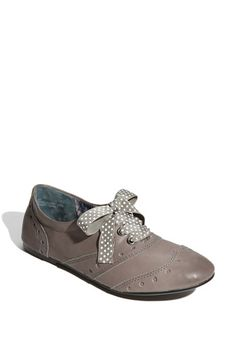 Vintage inspiration styles a classic oxford updated with a wide ribbon taking the place of traditional laces. $29.90
