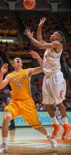 Valparaiso Crusaders' Alec Peters (25) watches as Illinois' Joseph Bertrand (2) shoots during the first half of an NCAA college basketball g...