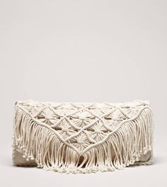 have to have this.....AEO Macrame Fringe Clutch