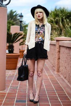 white blazer patterned top black skirt