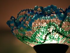Seriously love this lamp shade, made from melted plastic beads (think Mardi Gras!)