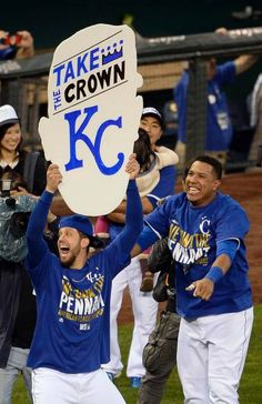 Kansas City Royals pitcher James Shields grabbed a giant sign with Kansas City Royals catcher Salvador Perez's head on it away from Perez during the celebration after the Royals beat the Orioles at Wednesday's ALCS playoff baseball game on October 15, 2014 at Kauffman Stadium in Kansas City, MO. The Royals defeated the Orioles 2-1 to win the ALCS.