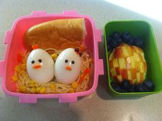 boiled egg chicks in a noodle and corn nest. French bread, apple in checkerboard design and blueberries.