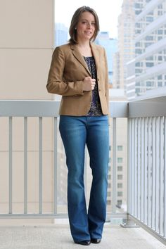 FashionablyEmployed.com | Beige blazer with flared jeans and booties for a casual business look for the office | Simple and sustainable style for everyday professional women | wear to work, office style, workwear