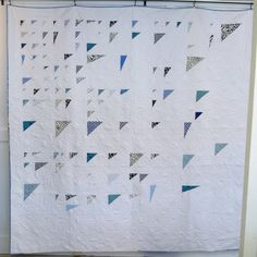 This queen-size blue and white Blues in Flight measures approximately 88x90. This quilt combines improvisational and modern patterns with traditional techniques. As a quilt, it is both modern and timeless. This is a truly unique heirloom made with care in the mountains of North Carolina.  Here at The Mountain Thread Company, we firmly believe that each and every item we make should be crafted with care, purpose, and beauty. We strongly support our local mountain culture and economy, and…