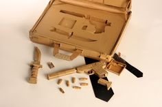 Cardboard weapons and case by Mark O'Brien