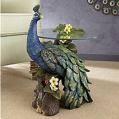 Like a proud prince in his royal vestments, this regal peacock strikes a noble pose, colorful tailfeathers on display. Captured in this stunning accent table, he commands every eye in the room. Peacock Room Decor, Peacock Wall Art, Peacock Bird, Peacock Colors, Peacock Feathers, Chalk Drawings, Clay Art, Home Decor Items, Beautiful Birds