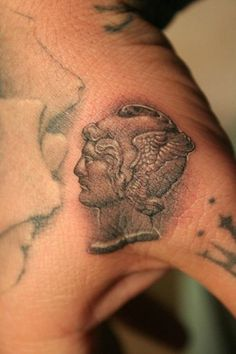 If you want to tattoo, make it serious: thumb tattoo of gladiator stone portrait by Ben Leland-Grillo