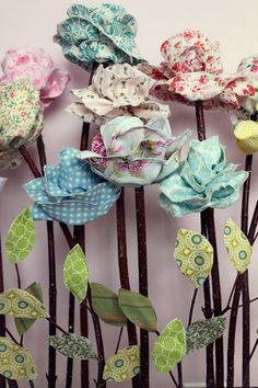 SnowyBliss: Long Stemmed Fabric Flowers... I wanted to add a bit of fabric flower goodness to my studio.  I've had these on the brain for quite some time and I finally got around to creating them.  I think spring inspired me.   So here's how they turned out…