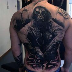 http://nextluxury.com/wp-content/uploads/gas-mask-black-ink-back-male-tattoo-ideas.jpg