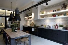 Kitchen Design Inspiration Industrial chic kitchen with black cabinets and white shelves with large vintage industrial lights, white subway tiles Industrial Chic Kitchen, Loft Industrial, Loft Kitchen, Shabby Chic Kitchen, Kitchen Interior, New Kitchen, Kitchen Ideas, Industrial Design, Industrial Bathroom