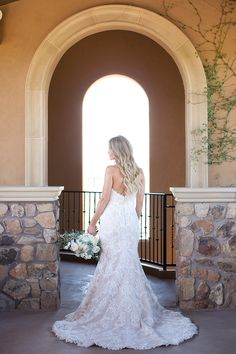 Long lace fit-and-flare dress with a train - Melissa Jill Photography
