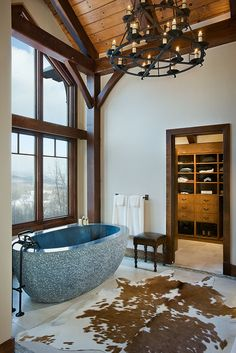 Solid granite bath tub. wow but how would you use the cow hide as a rug? get hair all over ur feet.