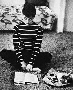 Audrey Hepburn reading with tea.