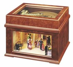 Antique music boxes, like this disc model with figures below which probably move as the music is played, make lovely accessories for a large table. If working, they also can have a very lovely, mellow sound.