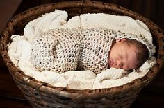 Hooded Cocoon.  There's just something about babies snuggled in yarn that makes my heart melt.