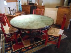 """54"""" copper table with turquoise patina."""