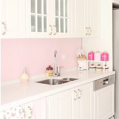 Cute pink and white kitchen