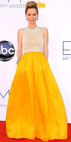 LESLIE MANN  One of the many women embracing citrus shades on the sweltering red carpet, the actress contrasts the marigold skirt of her Naeem Khan gown with turquoise Lorraine Schwartz jewels.
