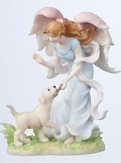 little dog with a Seraphim angel... I want this.