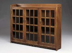 OAK TRIPLE DOOR BOOKCASE  GUSTAV STICKLEY, CIRCA 1904
