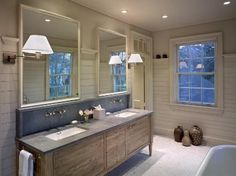 With minimal disruption to the main living areas, this careful remodel of a bathroom in an old home creates a serene space.<br>