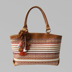 "Sumaqkay ""Deborah"" handbag : luxury handbags & accessories, made with handwoven fabrics by artisans from Paracas, Peru. Each bag is unique and is inspired by Nazca, Paracas and Wari cultures, known for its exquisite textile art. Sumaqkay combine traditional weaving techniques with pre-columbine and modern design to create the most original contemporary pieces."