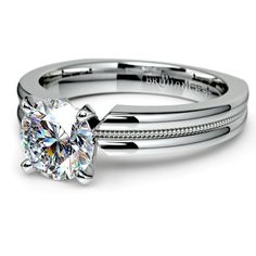 Practical beauty: When it's time to pop the question, do it with the stylish Rocker Milgrain Diamond ‎Solitaire Engagement Ring in sleek, durable Platinum. Its simple yet elegant setting will not clash with her unique style, and the metal will ensure that this ring lasts for generations!  http://www.brilliance.com/engagement-rings/rocker-milgrain-solitaire-ring-platinum