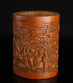 """Chinese Carved Bamboo Brush Pot  Intricately carved with figures on horses and children in an exterior setting, with caligraphy and seal mark along side. 7"""" H x 5.125"""" W. Excellent condition."""