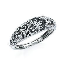 BEST BRACELET DESIGN    Under $2,500    Fleur de Lace bangle with hand-painted white Italian enamel and black cubic zirconia in black rhodium–plated sterling silver; $890; Belle Étoile