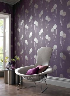 If you love the floral look, this Alium purple wallpaper, designed by Graham & Brown, may be your perfect choice. The shimmering grey stems contrast prettily with the purple linen-effect background. Find more decorating ideas at housebeautiful.co.uk