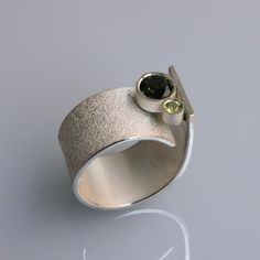 Contemporary handmade silver ring Q with by andreasschiffler