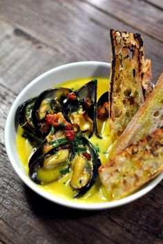 Choritos. Mussels with aji amarillo butter and pancetta at picca